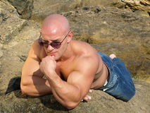 Bald man in sunglasses Stock Photography
