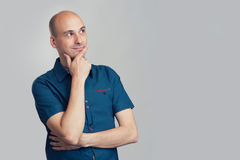 Bald man thinking and looking side Stock Photography