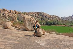 Bald Man is a tourist and photographer in Hampi. Large stones Hampi on the side of the village of Anegundi and Virupapur Gaddi. Large stones stock images