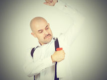 Bald man uses deodorant from a trigger. Stock Image