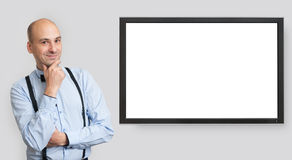Bald man wearing bow tie and suspenders Royalty Free Stock Images