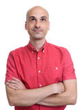 Bald man wearing red shirt looking up Royalty Free Stock Image