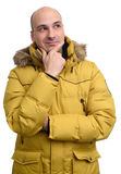Bald man wearing a yellow winter jacket Stock Photos