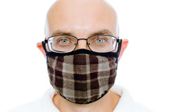 Bald man on a white background in the warm medical mask Royalty Free Stock Photo