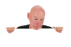 Bald man with white board Royalty Free Stock Image