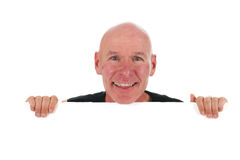 Bald man with white board. Portrait bald man with white board isolated in studio Royalty Free Stock Photos