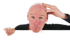 Bald man with white board Stock Images