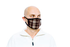 Bald, man in a white jacket and mask. Studio. isolated Stock Photos