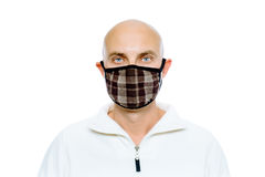 Bald, man in a white jacket and mask. Studio. isolated Stock Image