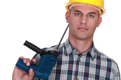Bald mason with drill Stock Photography