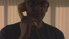 Bald men talking phone stock footage