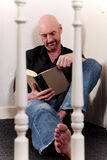 Bald middle aged man book Stock Photography