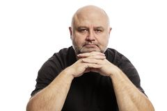 Bald middle-aged man, isolated on white background stock photography