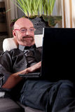 Bald middle aged man home Stock Photos