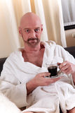 Bald middle aged man home Royalty Free Stock Image