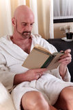 Bald middle aged man home Stock Images