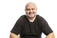 Bald middle aged man laughs, isolated on white background royalty free stock photos