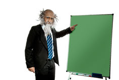 Bald old teacher points on blackboard Stock Images