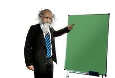 Bald old teacher points on blackboard Stock Images
