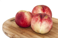 Bald peaches on the cutting board Stock Photography