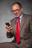 Bald senior businessman wearing glasses Stock Photos