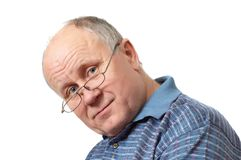Bald senior man with glasses Royalty Free Stock Images