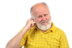 Bald senior man picking his ear Stock Photography