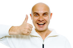 Bald smiling blue-eyed man with thumb up. Studio. isolated Royalty Free Stock Image
