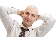 Bald smiling businessman Stock Photo