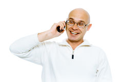 Bald smiling man speaking by phone. Studio. isolated Stock Photo