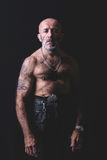 Bald and tattooed man Stock Image