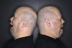 Bald twin men back to back. royalty free stock photos