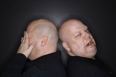 Bald twin men crying. Stock Photos