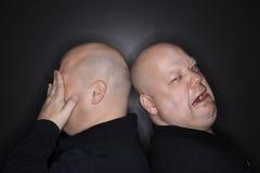 Bald twin men crying. stock photos