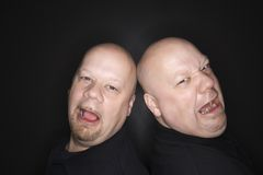 Bald twin men crying. royalty free stock photo