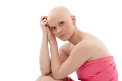 Bald woman in pink - Breast Cancer Awereness. Young hairless woman wrapped into pink textile Stock Photos