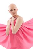 Bald woman in pink - Breast Cancer Awereness. Young hairless woman wrapped into pink textile Royalty Free Stock Photography