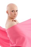 Bald woman in pink - Breast Cancer Awereness. Young hairless woman wrapped into pink textile Royalty Free Stock Photos