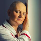 Bald woman suffering from cancer stock photos
