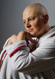 Bald woman suffering from cancer sitting in the chair Royalty Free Stock Photos