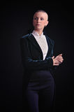 Bald woman in tailcoat Stock Photos