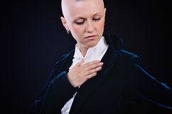 Bald woman. Bald young woman posing in studio Royalty Free Stock Photos