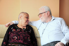 Old couple - cancer woman. Bald women because of cancer with her husband Royalty Free Stock Photography