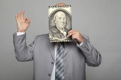 Bald young businessman with banknotes Stock Images