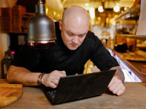 Bald young man looking at laptop Royalty Free Stock Photo