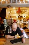 Bald young man looking at laptop Stock Photos