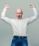 Bald young man portrait success hands up Stock Photography