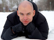 Bald young man  on the snow Stock Photography