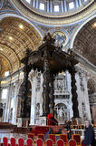 The baldachin altar made by Bernini in the Basilica San Pietro,. VATICAN, ITALY - MARCH 16, 2016: The famous wooden baldachin, altar of Saint Peter basilica was Royalty Free Stock Image