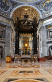 The baldachin altar made by Bernini in the Basilica San Pietro,. VATICAN, ITALY - MARCH 16, 2016: The famous wooden baldachin, altar of Saint Peter basilica was Stock Image
